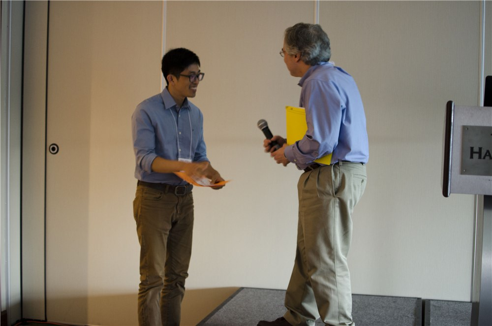 Kris Kim being issued the best poster award at SPM-on-SPM 2014, by Dr. Gregory F. Meyers from the Dow Chemical Company